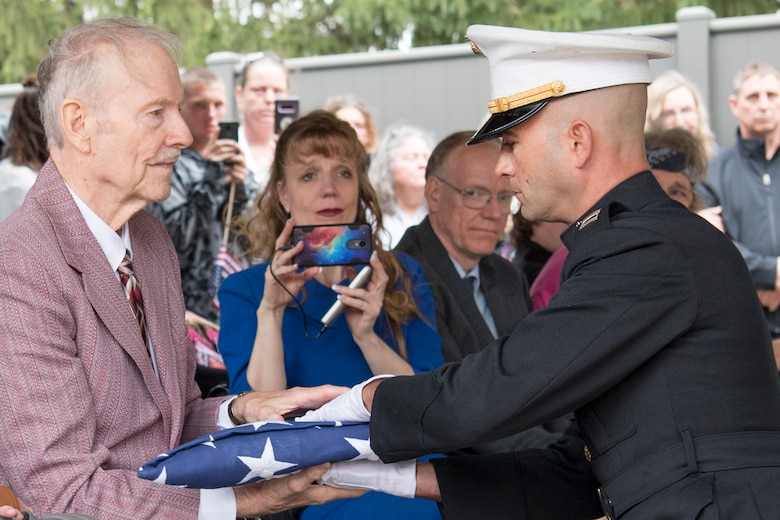 Capt. Pierce Virag, Detachment 1, Communications Company, Combat Logistics Regiment 45, 4th Marine Logistics Group, inspector instructor, presents the American flag to Roger Covey during the funeral of Pvt. Fred Freet April 18, 2019 at the Marion Indiana National Cemetery. The funeral was attended by multiple family members, military organizations, the Marion City Fire, Police and Sheriff's Department and veterans who came to pay their respect. (U.S. Air Force Photo/Master Sgt. Ben Mota)