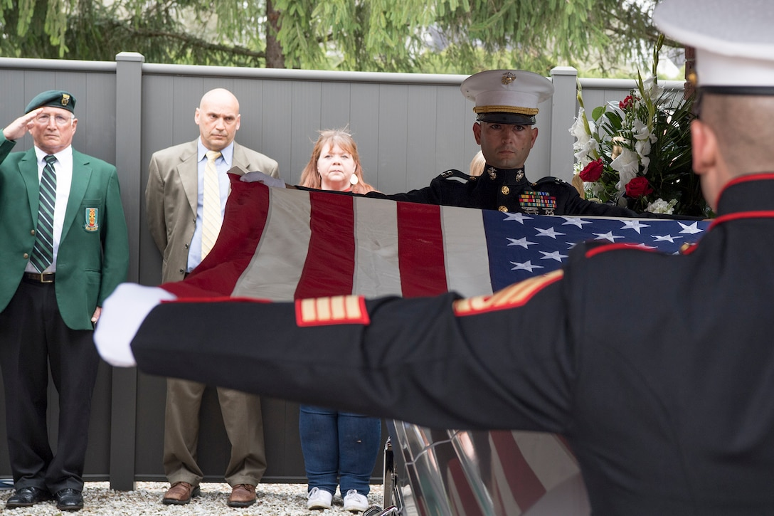 Capt. Pierce Virag and First Sgt. Philip Kent, Detachment 1, Communications Company, Combat Logistics Regiment 45, 4th Marine Logistics Group, honor guard team members perform a flag folding ceremony during the funeral of Pvt. Fred Freet April 18, 2019 at the Marion Indiana National Cemetery. The young Marine was killed in action during World War II, and declared by the military as unrecoverable killed in action until Aug. 6, 2018 when the U.S. Navy positively identified his remains. (U.S. Air Force Photo/Master Sgt. Ben Mota)
