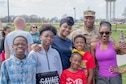 Active duty and Reserve Airmen with the 87th Air Base Wing and the 514th Air Mobility Wing, both located here, pose with their families by the softball quarts on April 18, 2019. The 514th is an Air Force Reserve Command unit located at Joint Base McGuire-Dix-Lakehurst, N.J.
