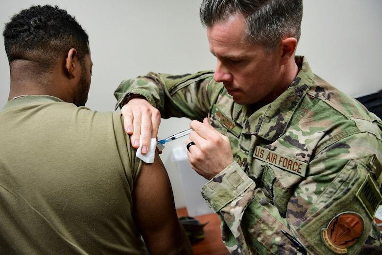 U.S. Air Force Tech Sgt. Joseph Anthony, medical technician with the 911th Aeromedical Staging Squadron, administers a vaccination to a member of the U.S. Army Reserve's 336 Engineering Company Command and Control, Chemical Radiological and Nuclear Response Enterprise Team at the Pittsburgh International Airport Air Reserve Station, Pennsylvania, April 11, 2019. Department of Defense issued vaccinations are used to prevent a variety of diseases that military members may encounter in the course of their duties. (U.S. Air Force photo by Joshua J. Seybert)