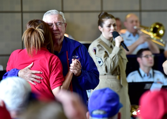 Attendees dance during the DFW Honor Flight concert, at Joint Base Anacostia-Bolling, April 13, 2019. The USAF Concert Band and Singing Sergeants honored military veterans from WWII, Vietnam and Korean War by playing music from the era. (U.S. Air Force photo by Staff Sgt. Cary Smith)