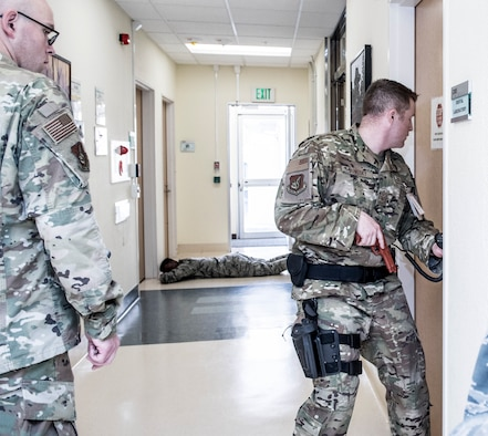 Tech. Sgt. Nick Yankosky, 374th Medical Support Squadron hospital operation section chief, checks rooms for bystanders during an active shooter exercise at Yokota Air Base, Japan, April 18, 2019.