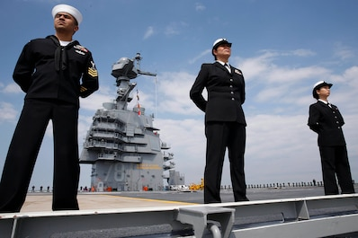 NORFOLK, Va. (April 14, 2017) -- Pre-Commissioning Unit Gerald R. Ford (CVN 78) Sailors man the rails as the ship returns to Norfolk after conducting builder's sea trials. The first-of-class ship -- the first new U.S. aircraft carrier design in 40 years -- has spent several days conducting builder's sea trials, a comprehensive test of many of the ship's key systems and technologies.(U.S. Navy photo by Mass Communication 3rd Class Matthew R. Fairchild)