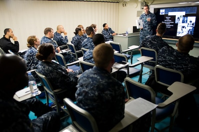 NEWPORT NEWS, Va. (April 20, 2015) -- Mass Communication Specialist 1st Class Patrick Grieco, assigned to Pre-Commissioning Unit Gerald R. Ford (CVN 78), gives a presentation on President Gerald R. Ford during the first indoctrination onboard the ship. Ford is currently undergoing outfitting and testing and is scheduled for delivery in spring 2016. (U.S. Navy photo by Mass Communication Specialist Seaman Kristopher Ruiz/ Released)