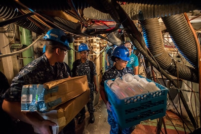 Pre-Commissioning Unit Gerald R. Ford (CVN 78) Sailors on-load ship galley supplies  in preparation for crew move aboard later this summer when the crew will begin living, working and eating aboard CVN 78.