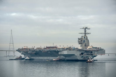 The aircraft carrier Gerald R. Ford (CVN 78) floats in the James River after being launched from dry dock at Newport News Shipbuilding, 11/17/2013. The ship will tied to an outfitting pier at the shipyard for equipment installation and testing.   The carrier is scheduled for commissioning in 2015. The Ford is the first ship of a new class of nuclear-powered aircraft carriers built by Newport News Shipbuilding for the U. S. Navy. Photo by Chris Oxley, Newport News Shipbuilding.