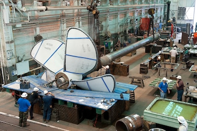 A propeller and shaft for the aircraft carrier Gerald R Ford CVN 78 undergo fitting opertions at the Newport News Shipbuilding machine shop 5/22/2012.