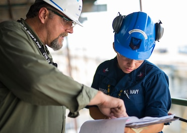 NEWPORT NEWS, Va. (Sept. 2, 2015) – Machinist's Mate 2nd Class Janie Sheshbaradaran, assigned to Pre-commissioning Unit Gerald R. Ford (CVN 78), and Thomas Bain, production controller for Supervisor of Shipbuilding (SUPSHIP) review areas and procedures for ventilation inspections aboard the ship. Ford is undergoing testing and outfitting in preparation for commissioning in spring of 2016. (U.S. Navy Photo by Mass Communication Specialist 3rd Class Ryan Litzenberger/Released)