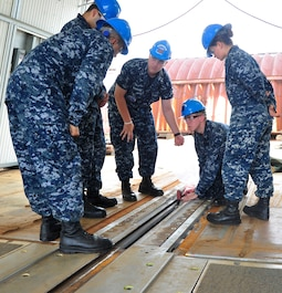 NEWPORT NEWS, Va. (Sept. 21, 2015) -- Aviation Boatswain's Mate (Equipment) 2nd Class David Vonbehren and Aviation Boatswain's Mate (Equipment) 3rd Class Hayden Bradford, assigned to Pre-commissioning Unit Gerald R. Ford (CVN 78), give training on the Electromagnetic Aircraft Launch System. EMALS is the first new shipboard aircraft launching technology that has been implemented on our Nation's aircraft carriers in 60 years. (U.S. Navy photo by Mass Communication Specialist 2nd Class Cory Rose/Released)