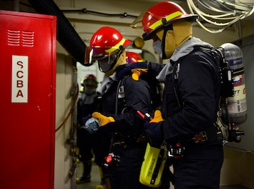 NEWPORT NEWS, Va. (Feb 4, 2016) --Sailors aboard Pre-Commissioning Unit Gerald R. Ford (CVN 78) participate in a firefighting drill on board the ship. As the first ship-wide drill focused on damage control and emergency responses, this was a significant step in certifying the crew as they train to fight and take delivery of the ship. (U.S. Navy photo by Mass Communication Specialist Seaman Cathrine Mae O. Campbell/Released)
