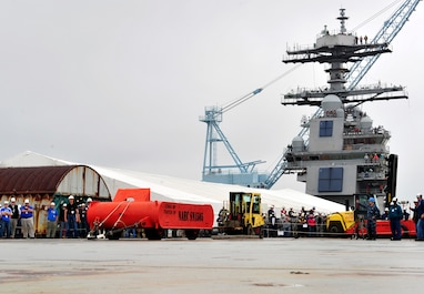 "NEWPORT NEWS, Va. (June 5, 2015) — As part of a joint test group, Sailors from Pre-Commissioning Unit Gerald R. Ford (CVN 78) prepare to launch a 16,000-pound sled from the ship's flight deck using the ship's Electromagnetic Aircraft Launch System (EMALS). Ford completed two successful ""dead-load"" tests on the initial test day; testing will continue over the next several weeks. (U.S. Navy Photo by Mass Communication Specialist 2nd Class Cory Rose/Released)"