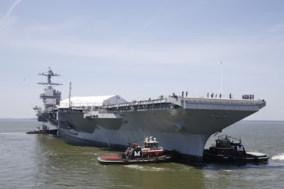 NEWPORT NEWS, Va. (June 11, 2016) -- Tug boats maneuver Pre-Commissioning Unit Gerald R. Ford (CVN 78), into the James River during the ship's turn ship evolution. This is a major milestone that brings the country's newest nuclear powered aircraft carrier another step closer to delivery and commissioning later this year. (U.S. Navy photo by Mass Communication Specialist 3rd Class Matthew R. Fairchild/Released)