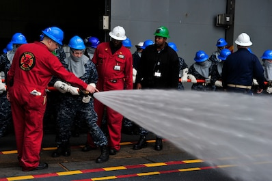 NEWPORT NEWS, Va. (Feb. 4, 2016) --  Pre-Commissioning Unit Gerald R. Ford's (CVN 78) Damage Control Training Team conducts firehose training during a general quarters drill. As the first ship-wide drill focused on damage control and emergency responses, this was a significant step in certifying the crew as they train to fight and take delivery of the ship. (U.S. Navy photo by Mass Communication Specialist Seaman Apprentice Joshua Murray/Released)
