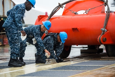 "NEWPORT NEWS, Va. (June 5, 2015) — As part of a joint test group, Sailors from the future USS Gerald R. Ford (CVN 78) prepare to launch a ""dead-load"" from the ship's Electromagnetic Aircraft Launch System (EMALS). Ford completed two successful dead-loads on the initial test day; testing will continue over the next several weeks. (U.S. Navy Photo by Mass Communication Specialist 1st Class Joshua J. Wahl/Released)"