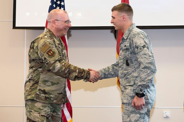 t. Col. Robert LaMore, 39th Air Base Wing inspector general, presents a coin to Airman 1st Class James Cline, 39th Security Forces Squadron modern facility operator, April 17, 2019, at Incirlik Air Base, Turkey.