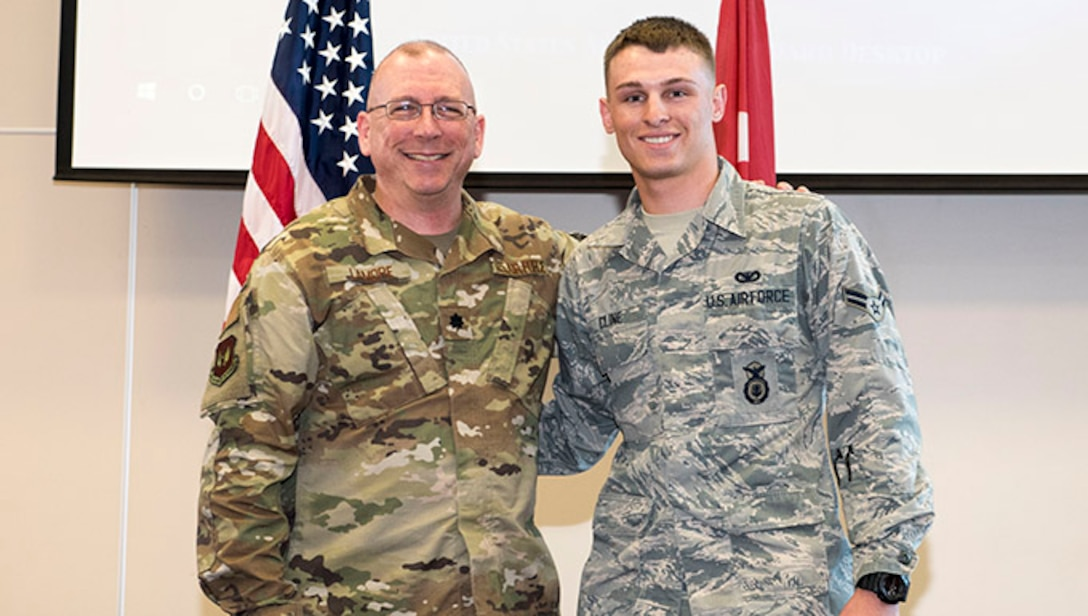 t. Col. Robert LaMore, 39th Air Base Wing inspector general, poses for a picture with Airman 1st Class James Cline, 39th Security Forces Squadron modern facility operator, April 17, 2019, at Incirlik Air Base, Turkey.