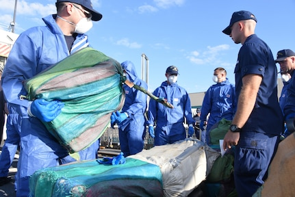 Coast Guard Cutter Bear (WMEC-901) crewmembers stage interdicted drugs on the flight deck of the cutter April 18, 2019 at Port Everglades, Florida.