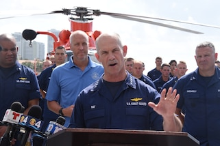 Admiral Charles Ray speaks during a press briefing on the flight deck of Coast Guard Cutter Bear (WMEC-901) before a drug offload April 18, 2019 at Port Everglades, Florida.