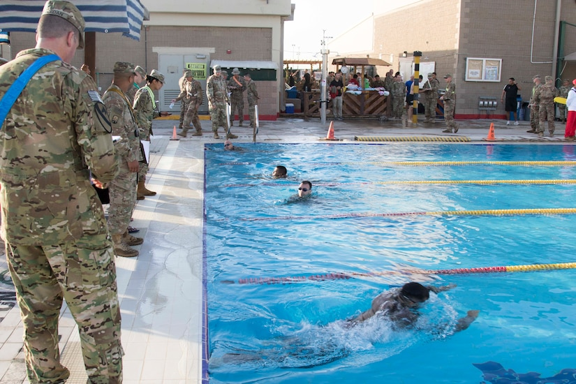 United States service members and coalition forces participate in the swim event of the German Armed Forces Badge (GAFB) for Military Proficiency on April 8, 2019, at Camp Arifjan, Kuwait. During this event, competitors must swim 100 meters in uniform within four minutes and then remove their uniform in the deep end without support. U.S. Army Central hosts events such as the GAFB to enhance service member's personal abilities to stay combat ready which improves overall capabilities.