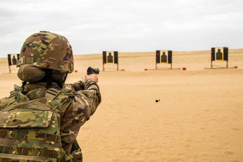 Army Staff Sgt. Danielle Reynolds, 637th Chemical, Biological, Radiological and Nuclear Company, shoots a Beretta M9 at targets during the range qualification event of the German Armed Forces Badge (GAFB) for Military Proficiency on April 9, 2019, at Udairi Range, Kuwait. During this event, participants stand and shoot a total of five rounds with a Beretta M9 at three silhouettes. Participants, who must hit each target at a minimum, shoot in order at targets one, two, three, one, two and earn bronze with three hits, silver for four hits and gold for five hits. U.S. Army Central hosts events such as the GAFB to enhance service member's personal abilities to stay combat ready which improves overall capabilities.