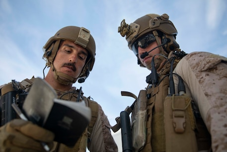 U.S. Marine Cpl. James Juarez, left, and Sgt. Nicholas Pirrone, Marines with the Maritime Raid Force, 22nd Marine Expeditionary Unit, review notes on a suspect during Visit, Board, Search and Seizure training aboard the Whidbey Island-class amphibious dock landing ship USS Fort McHenry (LSD-43). The Marines practiced boarding and searching a compliant vessel while implementing proper detainee handling. Marines and Sailors with the 22nd MEU and Kearsarge Amphibious Ready Group are currently deployed to the U.S. 5th Fleet area of operations in support of naval operations to ensure maritime stability and security in the Central Region, connecting the Mediterranean and the Pacific through the western Indian Ocean and three strategic choke points. (U.S. Marine Corps photo by Lance Cpl. Antonio Garcia/Released)