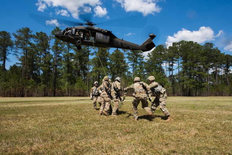 Airmen demonstrate Fast Rope Insertion Extraction System ability