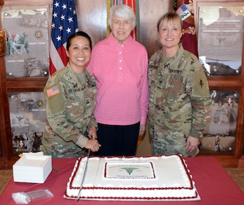 (From left) Capt. Kristin A. de Guzman, retired Col. Jessie Breuer and Col. Sara J. Spielmann at the cake-cutting ceremony at the U.S. Army Medical Department Center and School, Health Readiness Center of Excellence, or AMEDDC&S HRCoE, headquarters building at Joint Base San Antonio-Fort Sam Houston April 16.