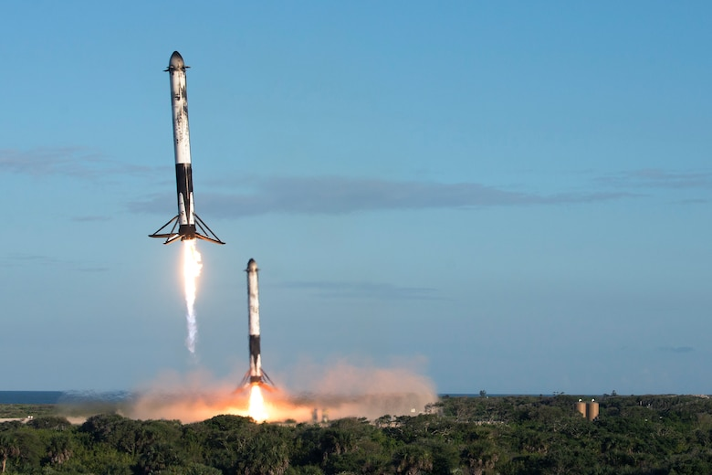 Two reusable rocket boosters land after the successful launch of SpaceX's Falcon Heavy Arabsat 6A