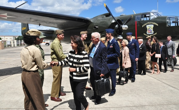 "The family of retired U.S. Air Force Lt. Col. Richard ""Dick"" E. Cole shake hands with Airmen dressed in WWII uniforms at a B-25 Mitchell static display during a memorial service for their father at Joint Base San Antonio-Randolph April 18. Cole, the last surviving Doolittle Raider, was the co-pilot on a B-25 Mitchell for then-Col. Jimmy Doolittle during the storied World War II Doolittle Tokyo Raid."