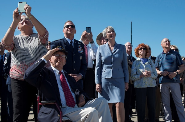 "Secretary of the Air Force Heather Wilson, U.S. Air Force Chief of Staff Gen. David L. Goldfein and memorial attendees watch flyover during a memorial service celebrating the life of retired U.S. Air Force Lt. Col. Richard ""Dick"" E. Cole at Joint Base San Antonio-Randolph April 18. Cole, the last surviving Doolittle Raider, was the co-pilot on a B-25 Mitchell for then-Col. Jimmy Doolittle during the storied World War II Doolittle Tokyo Raid."