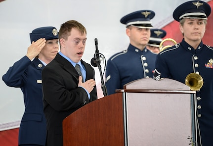 "Aaron Cole, a grandson of retired U.S. Air Force Lt. Col. Richard ""Dick"" E. Cole, sings the national anthem during a memorial service for his grandfather at Joint Base San Antonio-Randolph April 18. Cole, the last surviving Doolittle Raider, was among 80 Airmen who took part in the storied World War II Doolittle Tokyo Raid and was a founding Airman of the USAF Special Operations community"