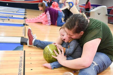 Alyssa Carvajal bowls with her son, Easton, Jan. 30, 2019, at the bowling event held by Exceptional Family Member Program-Family Support at Hill Air Force Base, Utah.