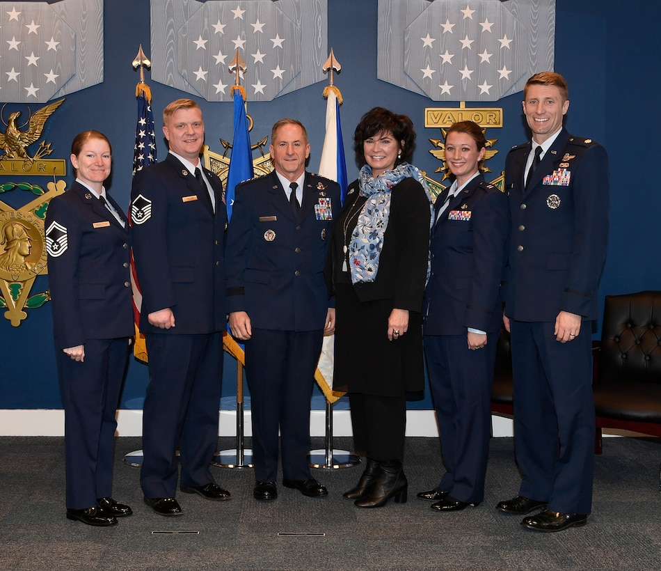 Senior Master Sgt. Alison Middleton, Master Sgt. Joshua Phillips, Capt. M. Helen Marino and Lt. Col. Mark Garlow, recipients of the 2017 Lance P. Sijan award, stand with Air Force Chief of Staff Gen. David L. Goldfein and Ms. Janine Sijan-Rozina at the Pentagon, in Arlington, Va., April 17, 2019. Sijan was the first Air Force Academy graduate to receive the Medal of Honor for his bravery and courage while evading capture and during his subsequent captivity as a prisoner of war after being shot down over Vietnam on Nov. 9, 1967. (U.S. Air Force photo by Andy Morataya)