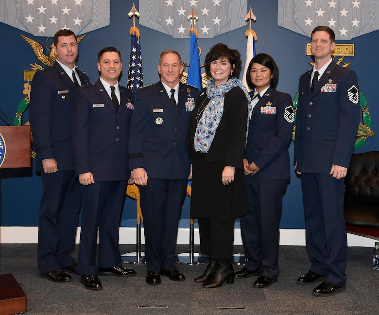 Lt. Col.  Martin O'Brien, 1st Lt. Jason Quadros, Master Sgt. Veronica Babauta and Master Sgt. Robert Perz, recipients of the 2018 Lance P. Sijan award, stand with Air Force Chief of Staff Gen. David L. Goldfein and Ms. Janine Sijan-Rozina at the Pentagon, in Arlington, Va., April 17, 2019. Sijan was the first Air Force Academy graduate to receive the Medal of Honor for his bravery and courage while evading capture and during his subsequent captivity as a prisoner of war after being shot down over Vietnam on Nov. 9, 1967. (U.S. Air Force photo by Andy Morataya)