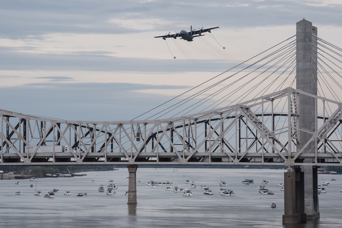 An HC-130 Hercules aircraft from Patrick Air Force Base, Fla., deploys its refueling drogues over the Ohio River during the Thunder Over Louisville airshow in Louisville, Ky., April 13, 2019. The Kentucky Air National Guard once again served as the base of operations for military aircraft participating in the annual event, which has grown to become one of the largest single-day air shows in North America. (U.S. Air National Guard photo by Dale Greer)