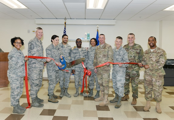 U.S. Air Force Col. Sherri LeVan, 55th Wing vice commander, cuts a ribbon April 15, 2019, during the Offutt Food Pantry ribbon cutting ceremony inside the Ehrling Bergquist Clinic at Offutt Air Force Base, Nebraska. LeVan also gave the opening remarks declaring the importance of the new food pantry helping individuals who are in need. (U.S. Air Force photo by Charles J. Haymond)