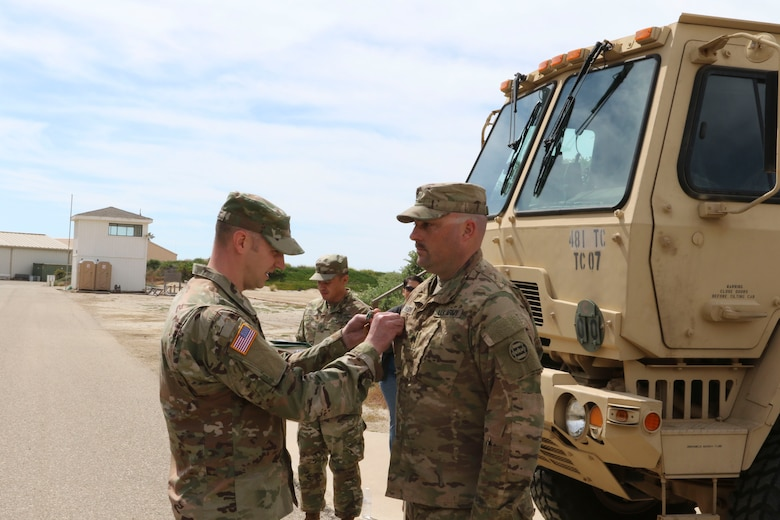 Capt. Schuyler Wessels, commander of the of the 481st Transportation (Heavy Boat) Company, 3rd Transportation Command (Expeditionary), pins the Army Commendation Medal onto Sgt. James Lawson during a ceremony on Port Hueneme, Calif., April 5, 2019.