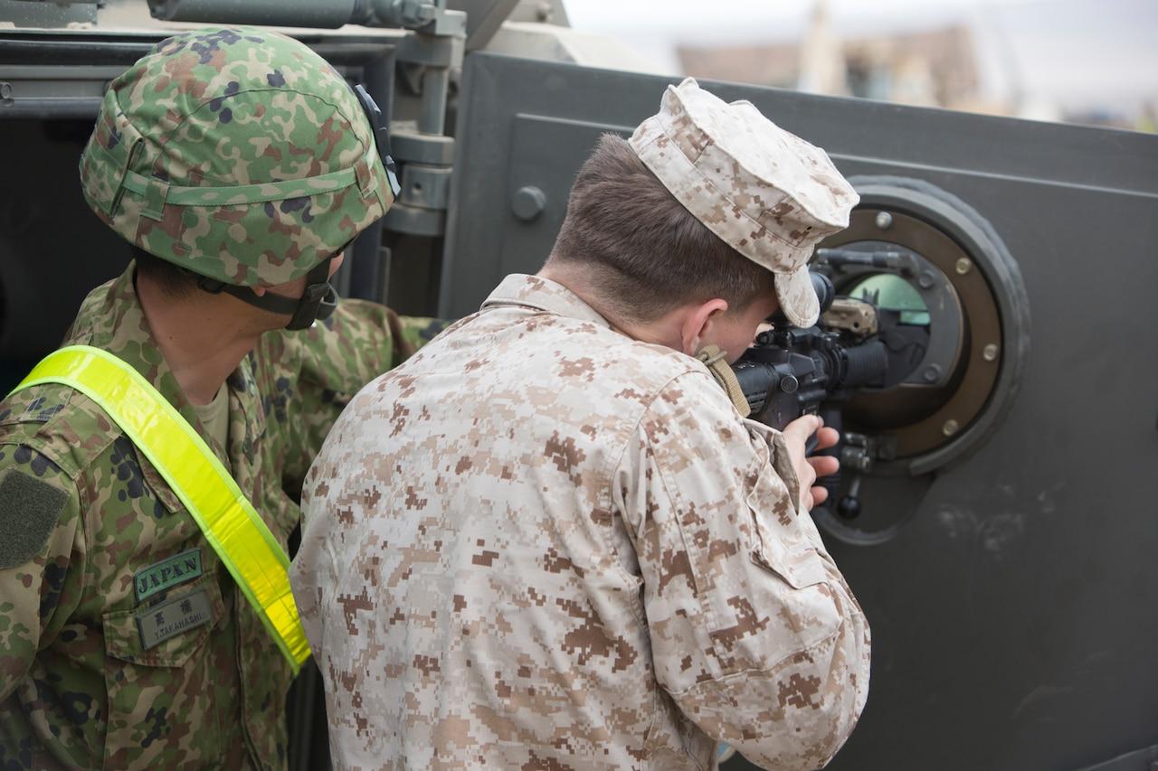 Soldier sites gun