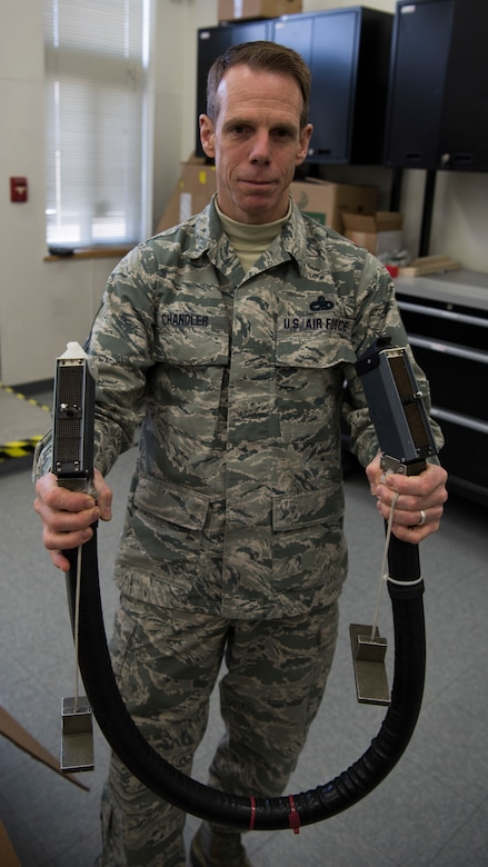 U.S. Air Force Senior Master Sgt. Mike Chandler, 142nd Maintenance Squadron out of the Portland Air National Guard, displays his avionics Electronics Systems Test Station (ESTS) cable tester that he designed. Chandler's invention reduces a two hours task to a 30 second task, saving time, money and enhancing readiness.