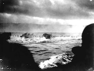 Omaha Beach: LCVPs from the Samuel Chase approach under fire.
