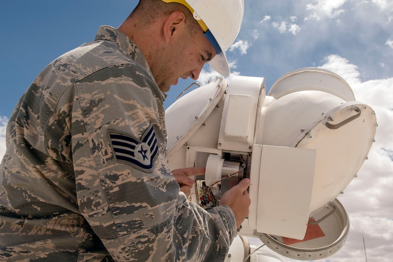Staff Sgt. Bradley Douglas, 2d Weather Squadron, Detachment 4, central repair activity technician performs an inspection of a declination head April 11, 2019, at the Solar Observatory on Holloman Air Force Base, N.M. The inspection involves verifying the wires are still serviceable and properly connected to the drive gear assembly and gear tachometer. (U.S. Air Force photo by Staff Sgt. Christine Groening)