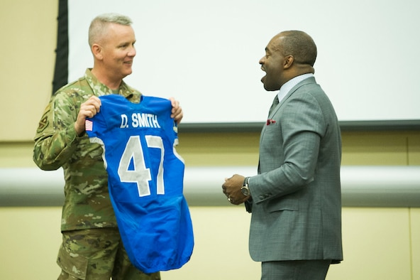 DeMaurice F. Smith, NFL Players Association executive director, shares a laugh with AFDW Commander Maj. Gen. James A. Jacobson, who presented him a custom-made Air Force Academy jersey during the 2019 AFDW Squadron Commander and Spouse Orientation Course at Joint Base Andrews, Maryland, April 17, 2009. (U.S. Air Force photo by Master Sgt. Michael B. Keller)