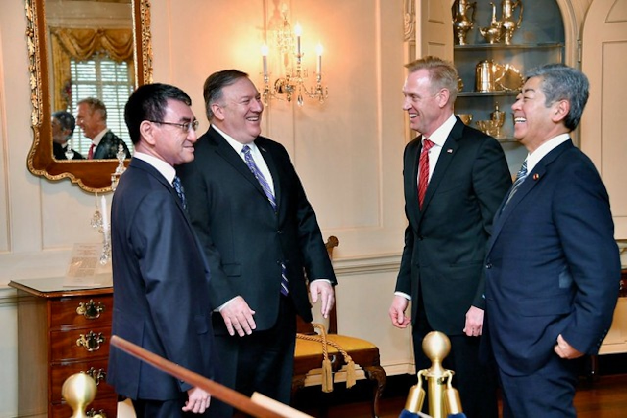 Acting Defense Secretary Patrick M. Shanahan, Secretary of State Michael R. Pompeo and two Japanese leaders stand in a half circle.