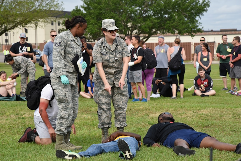 U.S. Air Force Staff Sgt. Erica Jenkins, 81st Medical Operations Squadron family health clinic team lead, and Capt. Jennifer Thomas, 81st Aerospace Medicine Squadron base operational medicine clinic physician assistant, discuss patient triage during a mass casualty and response exercise on Keesler Air Force Base, Mississippi, April 17, 2019. The scenario for the two-day event included a simulated plane crash with debris landing both on and off base in crowds of people. The exercise tested base and local civilian emergency response organizations' ability to operate in a multi-agency and multi-jurisdiction crisis situation. (U.S. Air Force photo by Kemberly Groue)