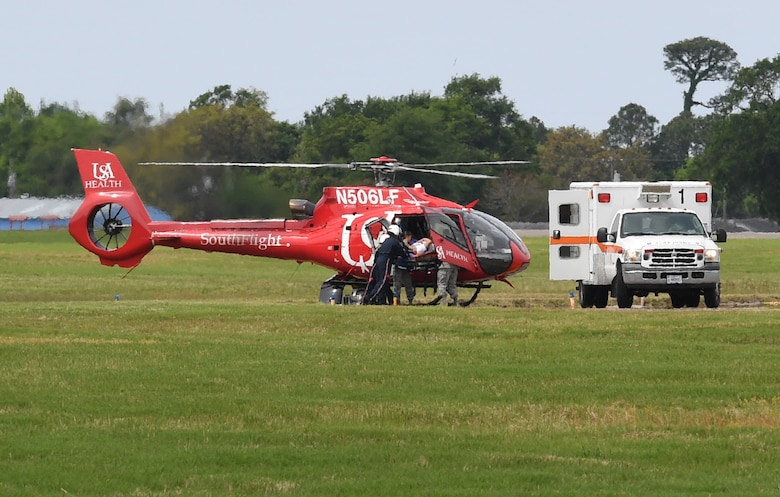 "Members of the 81st Medical Group transports a ""victim"" onto the University of South Alabama Medical Center SouthFlight Helicopter during a mass casualty and response exercise on Keesler Air Force Base, Mississippi, April 17, 2019. The scenario for the two-day event included a simulated plane crash with debris landing both on and off base in crowds of people. The exercise tested base and local civilian emergency response organizations' ability to operate in a multi-agency and multi-jurisdiction crisis situation. (U.S. Air Force photo by Kemberly Groue)"