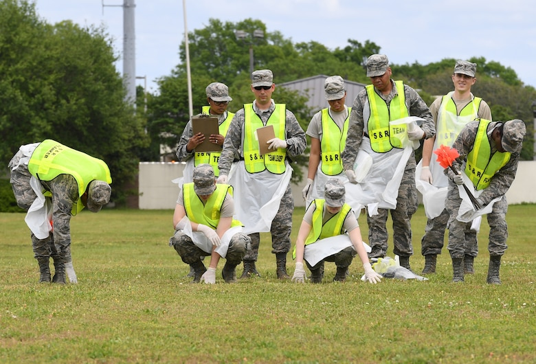 Members of the 81st Force Support Squadron Search and Recovery Team conduct a sweep of the scene during a mass casualty and response exercise on Keesler Air Force Base, Mississippi, April 17, 2019. The scenario for the two-day event included a simulated plane crash with debris landing both on and off base in crowds of people. The exercise tested base and local civilian emergency response organizations' ability to operate in a multi-agency and multi-jurisdiction crisis situation. (U.S. Air Force photo by Kemberly Groue)