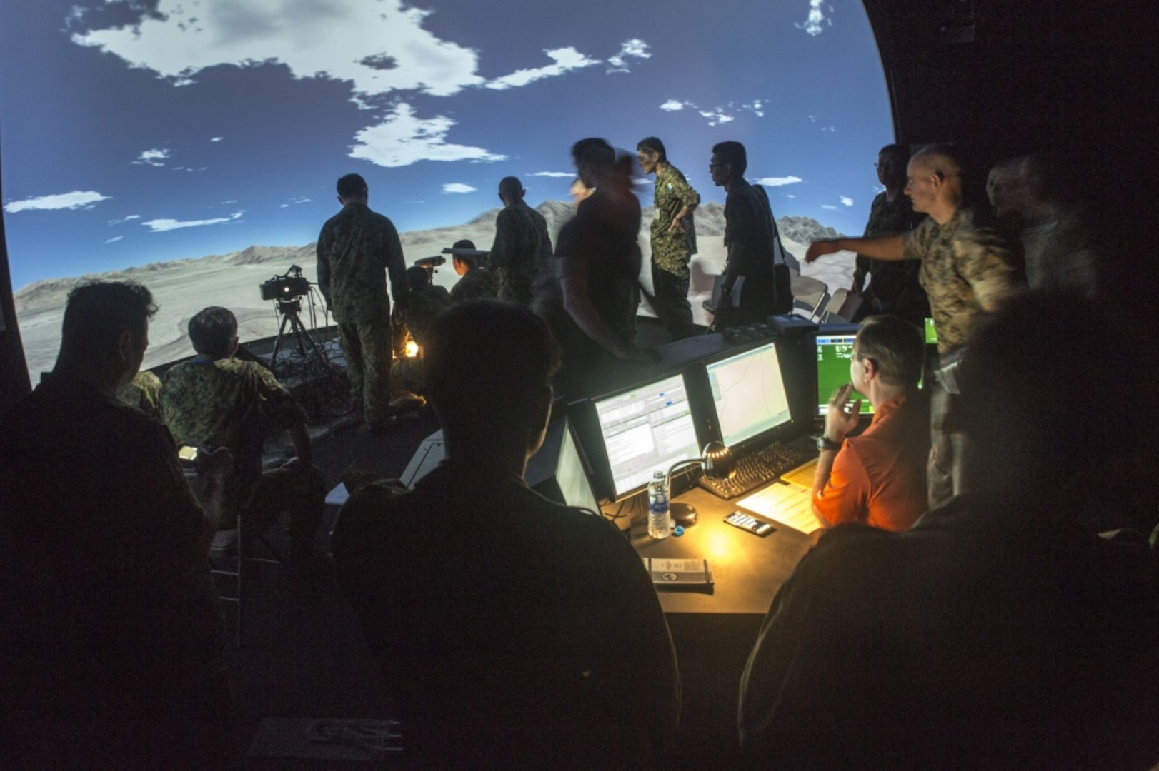Service members with the Japan Ground Self-Defense Force simulate calls-for-fire drills in the Supporting Arms Virtual Trainer on Camp Hansen, Okinawa, Japan, April 9, 2019. This observation and exchange provided opportunities for the 31st MEU Marines, and JGSDF personnel, to increasing understanding and interoperability. The 31st MEU, the Marine Corps' only continuously forward-deployed MEU, provides a flexible and lethal force ready to perform a wide range of military operations as the premier crisis response force in the Indo-Pacific region. (Official Marine Corps photo by Lance Cpl. Harrison C. Rakhshani/Released)