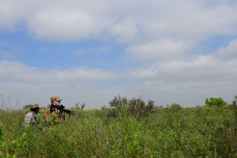 Airman 1st Class Colin Aranza and Senior Airman Samantha Hall, 47th Security Forces Squadron partolmen, keep a watchful eye on their surroundings during an exercise at Laughlin Air Force Base, Texas, April 17, 2019. The 47th SFS changed up the tempo with an exercise that challenged their tactics, teamwork and physical fitness as they were put head to head with a simulated opposing force. (U.S. Air Force photo by Senior Airman Benjamin N. Valmoja)