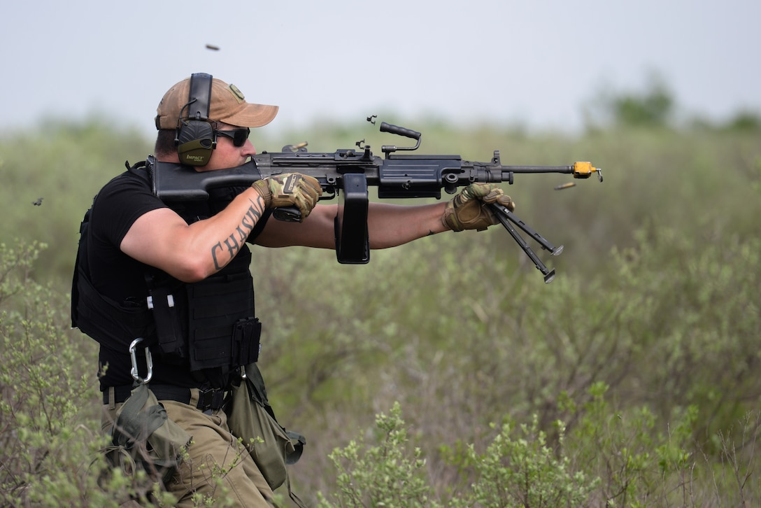 Johannes Thiel, 47th Security Forces Squadron patrolman, lays down suppressive fire as his team advances on opposing forces during an exercise at Laughlin Air Force Base, Texas, April 17, 2019. Thiel, a former U.S. Marine, brings his combat experience to Laughlin and got a chance to challenge his tactics, teamwork and physical fitness as he and his team were put head to head with a simulated opposing force, consisting of many coworkers he works with daily. (U.S. Air Force photo by Senior Airman Benjamin N. Valmoja)