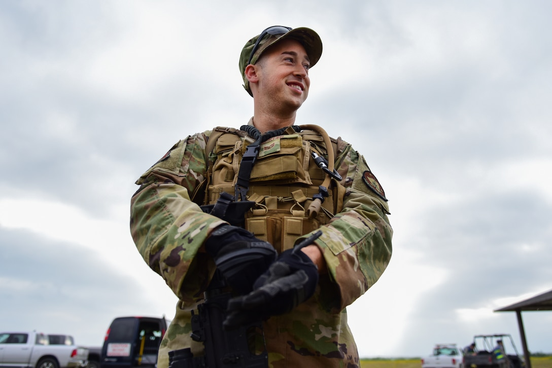 Staff Sgt. Nicholas Heckler, 47th Security Forces Squadron military working dog handler, prepares for a long day in the field at Laughlin Air Force Base, Texas, April 17, 2019. The 47th SFS changed up the tempo with an exercise that challenged their tactics, teamwork and physical fitness as they were put head to head with a simulated opposing force. (U.S. Air Force photo by Senior Airman Benjamin N. Valmoja)